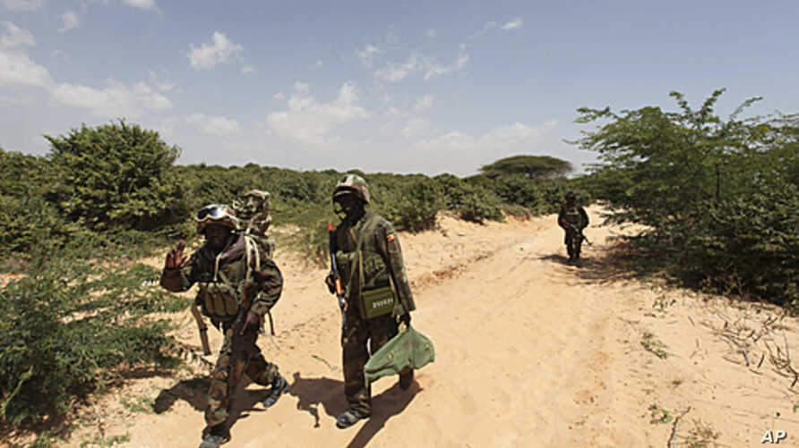 Ugandan peacekeepers from the African Union Mission in Somalia (AMISOM) patrol a road following an encounter with Islamist militia in the northern suburbs of Somalia's capital Mogadishu, January 20, 2012.