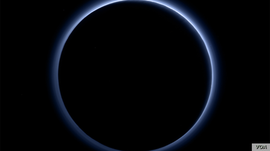 Pluto's haze layer shows its blue color in this picture taken by the New Horizons Ralph/Multispectral Visible Imaging Camera (MVIC). The high-altitude haze is thought to be similar in nature to that seen at Saturn's moon Titan. The source of both ha