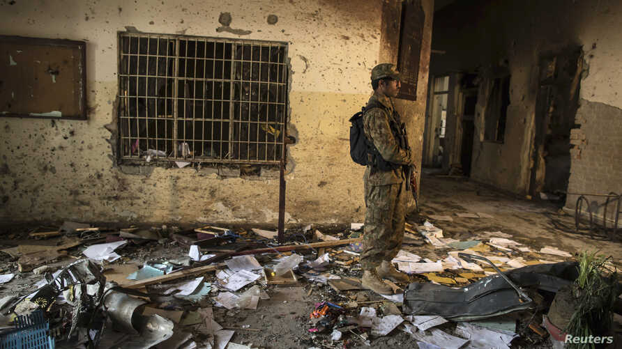 An army soldier stands in the Army Public School, which was attacked by Taliban gunmen, in Peshawar, Dec. 17, 2014. Taliban gunmen in Pakistan took hundreds of students and teachers hostage. More than 140 people died in the massacre. Umar Mansoor was