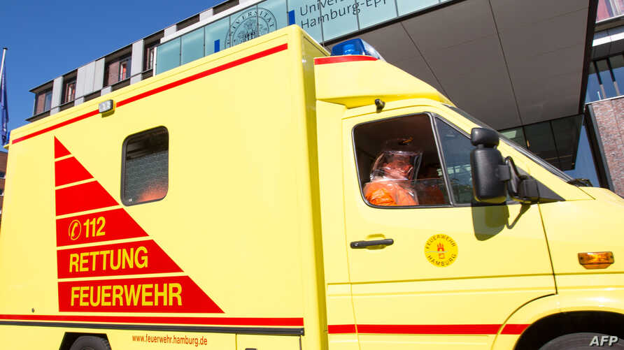 An ambulance carrying onboard a patient infected with the Ebola virus arrivres at the Universitaetsklinikum Hamburg Eppendorf (UKE) university hospital in Hamburg, northern Germany, August 27, 2014.