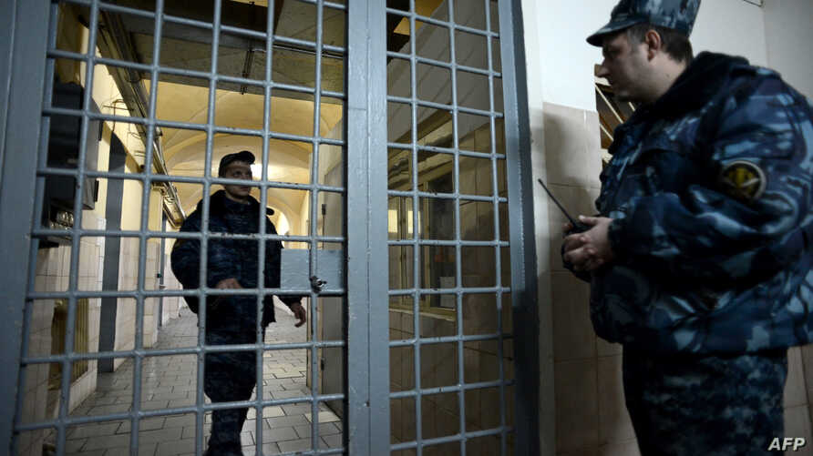 FILE - Guards stand in a prison lobby in Moscow, Russia, Dec. 4, 2013.