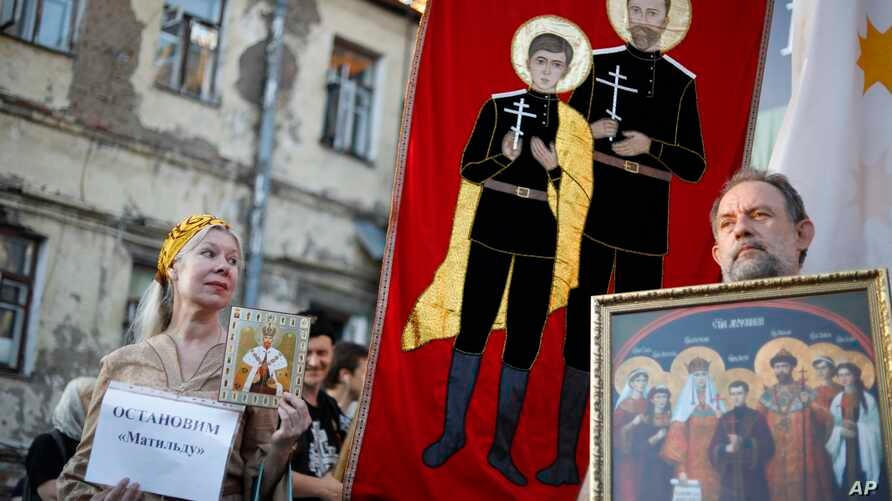 """An Orthodox protester holds up a sign reading """"Stop Matilda"""" during a protest against the release of a movie depicting a liaison of Russia's last czar in Moscow, Russia, Aug. 1, 2017. Russia's Culture Ministry says that a controversial historical fil"""