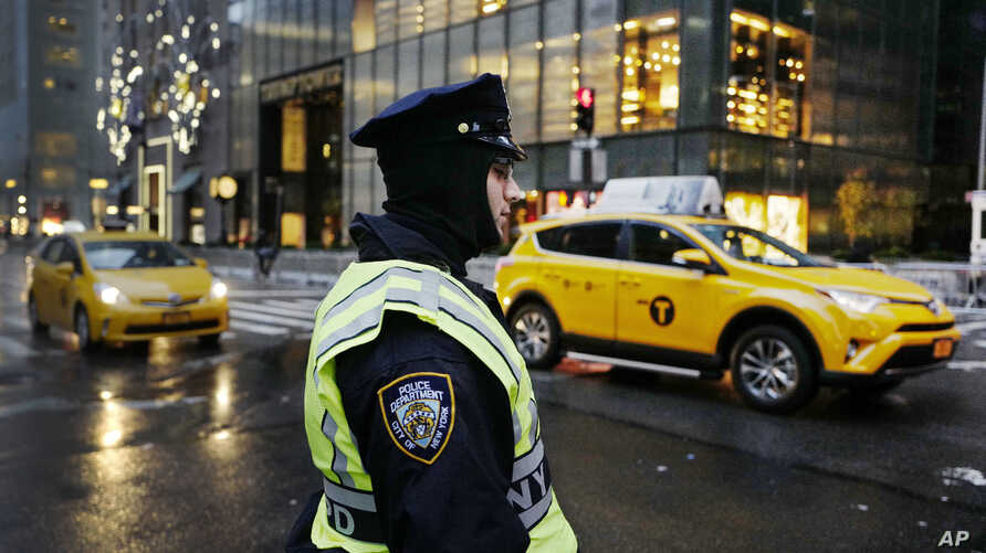 A New York City police officer stands watch outside Trump Tower, Dec. 5, 2016, in New York.