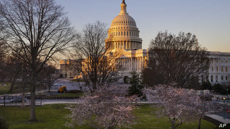 The Capitol in Washington is seen at sunup, March 23, 2017, as the House Republican leadership scrambles for votes on their health care overhaul.
