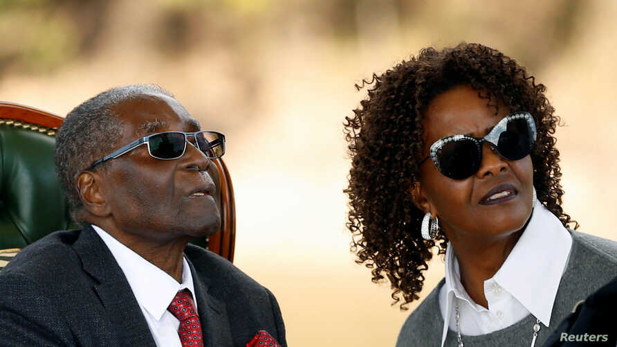 "Zimbabwe's former president Robert Mugabe and his wife Grace look on after addressing a news conference at his private residence nicknamed ""Blue Roof"" in Harare, Zimbabwe, July 29, 2018."