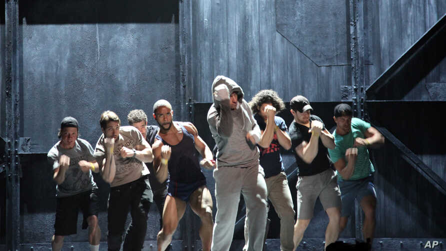 """Andy Karl, center, performs with the cast of """"Rocky: The Musical,"""" during a rehearsal for the Tony Awards at Radio City Music Hall in New York, June 6, 2014."""