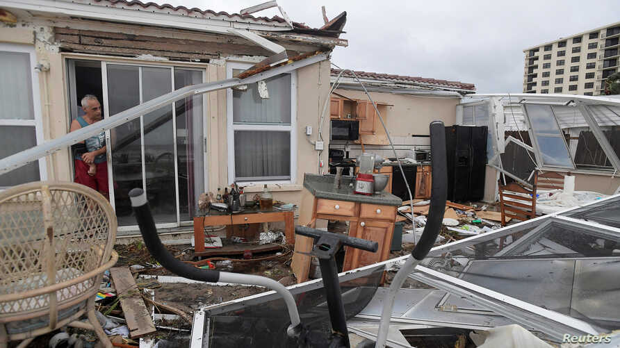 Homeowner Joe Lovece surveys the damage to the kitchen at the back of his oceanfront home after the eye of Hurricane Matthew passed Ormond Beach, Florida, on October 7, 2016. Lovece rode out the storm as waves took away the room at the back of his h