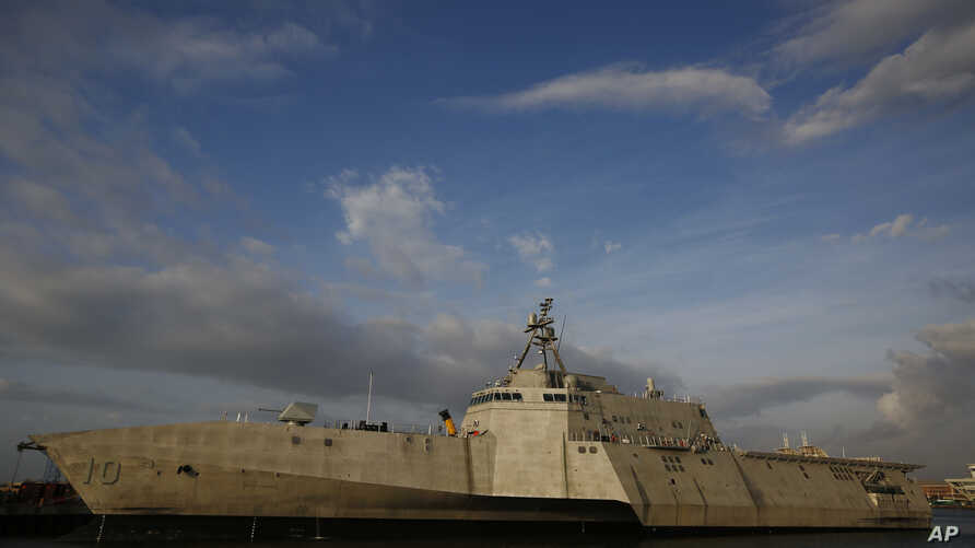 FILE - The USS Gabrielle Giffords, a Naval littoral combat ship built at the Austal USA shipyards, is docked on the Mobile River in Mobile, Ala., Nov. 30, 2016.
