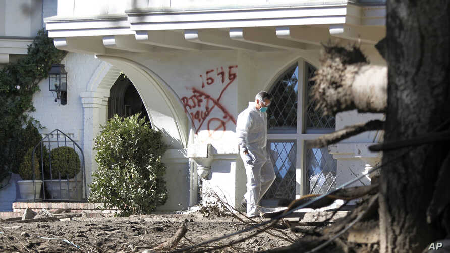 A Montecito resident searches his home for the first time near East Valley Road in Montecito, Calif., Jan. 25, 2018.