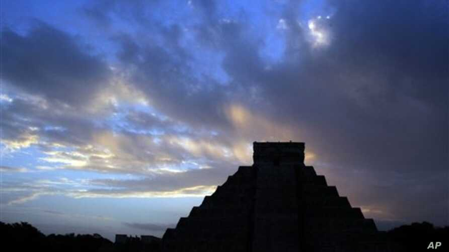 The sun rises behind Kukulkan temple in the Mayan ruins of Chichen Itza, Mexico, Dec. 2012 file photo.