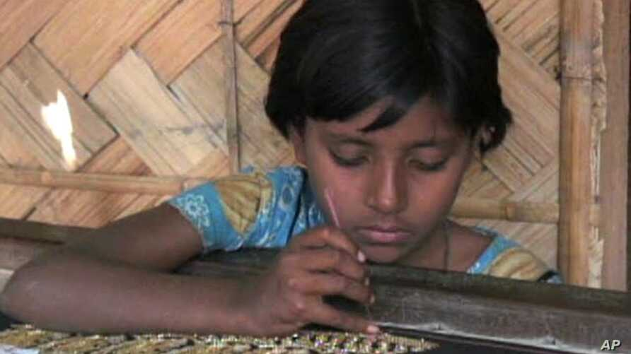 Sabina, 13, is forced to do textile work for her family's economic survival in Rashkali, India.