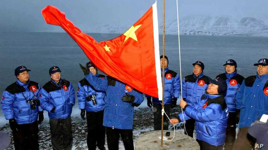 FILE - The Chinese national flag is raised in Longyearbyen on Svalbard, Norway, to set the site of a Chinese research station, Oct. 31, 2001.