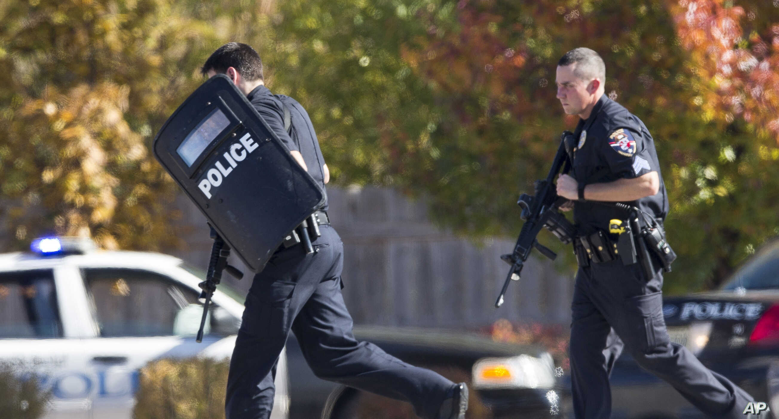 Police and swat team members respond to a call of a shooting at the Azana Spa in Brookfield, Wisconsin on Sunday,Oct. 21, 2012.
