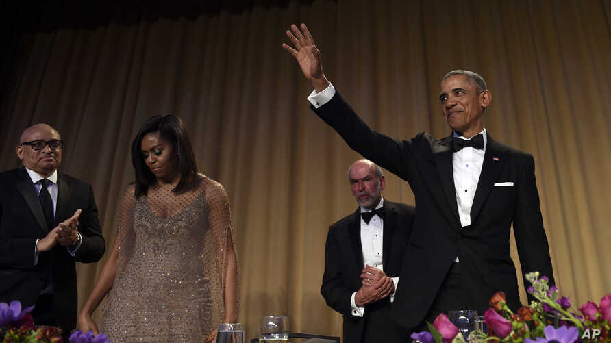 President Barack Obama, right, waves after speaking at the annual White House Correspondents' Association dinner at the Washington Hilton, in Washington, April 30, 2016.