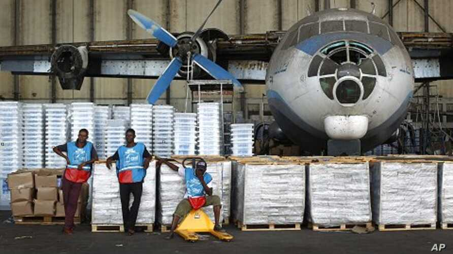 Congolese National Independent Electoral Commission workers wait to load planes and helicopters with election related equipment and ballots at Kinshasa Airport in Kinshasa, Democratic Republic of Congo, November, 25, 2011.