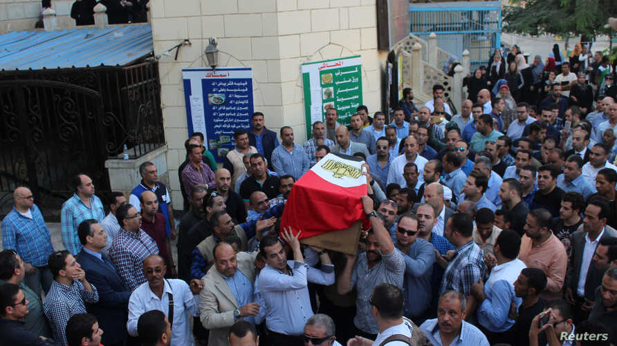 People carry the coffin of Egyptian police officer Ahmed Fayez, who was attacked with other security forces by militants in Egypt's western desert, in El Hosary Mosque outside Cairo, Oct. 21, 2017.