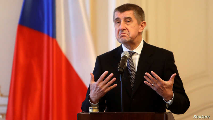 Czech Prime Minister Andrej Babis speaks to media after tendering the resignation of his cabinet to President Milos Zeman at the Prague, Castle in Prague, Czech Republic, Jan. 24, 2018.