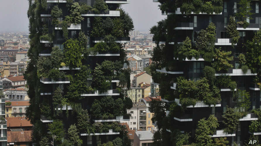 "The twin towers of the Bosco Verticale (Vertical Forest) residential buildings at the Porta Nuova district rise above Milan, Italy, on Aug. 3, 2017. Designed by the Boeri studio, it was named ""2015 Best Tall Building Worldwide"" by the Council on Tall"