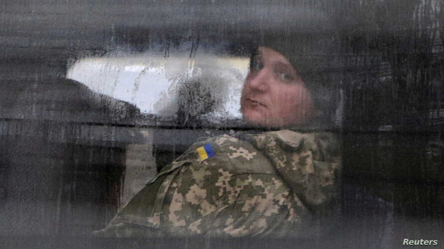A detained Ukrainian serviceman and crew member of one of Ukrainian naval ships recently seized by Russia's FSB security service looks out of a minibus window outside a court building in Simferopol, Crimea, Nov. 28, 2018.