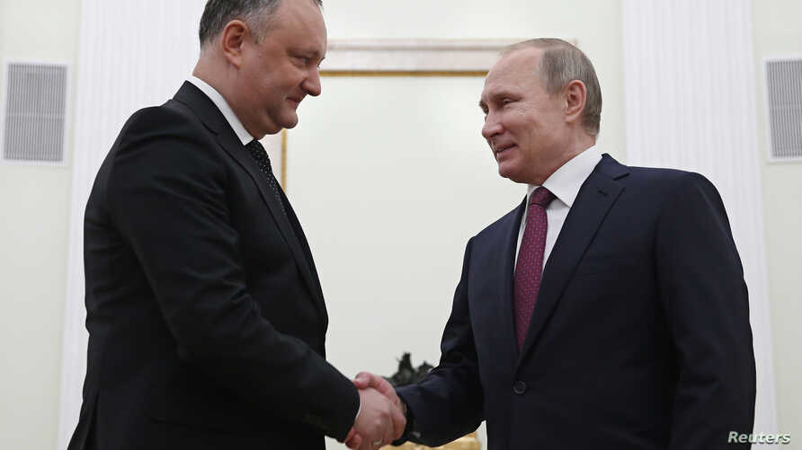 Russian President Vladimir Putin, right, shakes hands with his Moldovan counterpart Igor Dodon during a meeting at the Kremlin in Moscow, Jan. 17, 2017.