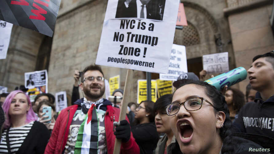 Protesters demonstrate against Republican U.S. presidential candidate Donald Trump in midtown Manhattan in New York City, April 14, 2016.