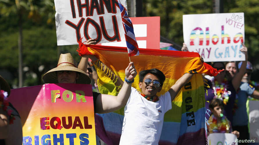 Supporters of same-sex marriage celebrate while the Hawaii State Senate convenes to approve a bill to legalize same-sex unions in the state of Hawaii, in Honolulu November 12, 2013.