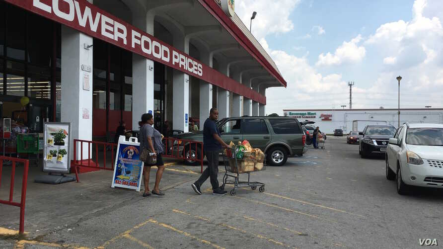 Shoppers stock up on groceries and bottled water at Fiesta Grocery store in southwest Houston at Bellaire Blvd. and South Gessner Road.