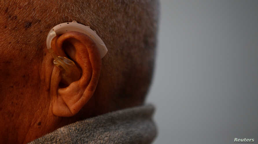 FILE - An 85-year-old Nepalese man is seen fitted with a hearing aid, in Kathmandu, Nepal, April 12, 2017.