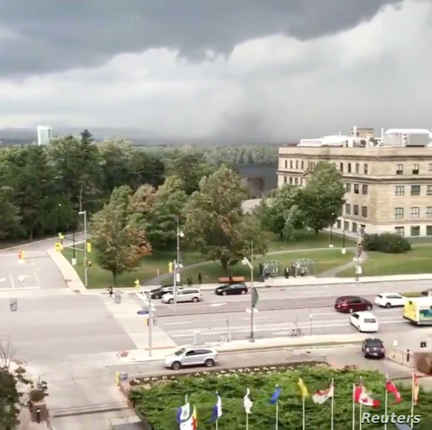 A tornado in Gatineau, Quebec, after a storm, is seen from Ottawa, Ontario, Sept. 21, 2018, in this still image taken from a social media video.