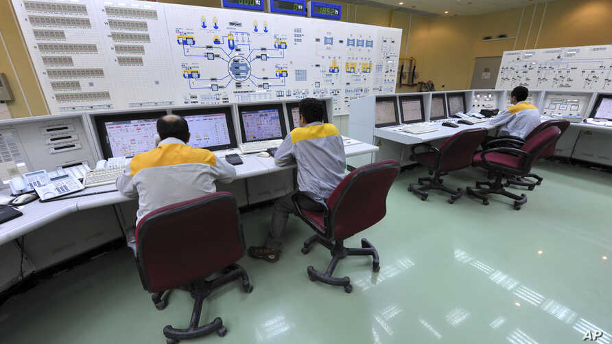 In this photo released by the International Iran Photo Agency, technicians work at the Bushehr nuclear power plant, outside the southern city of Bushehr, August 23, 2010.