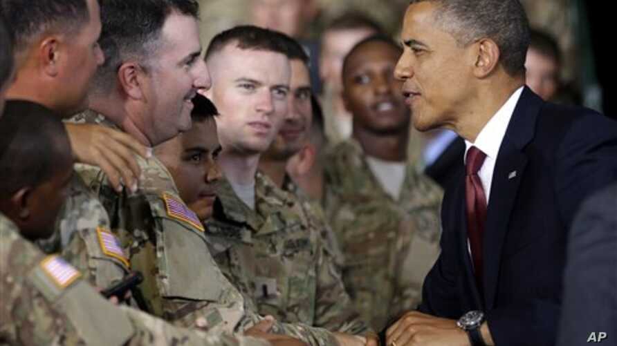 President Barack Obama (R) greets members of the military before speaking at Fort Bliss, Texas, August 31, 2012.