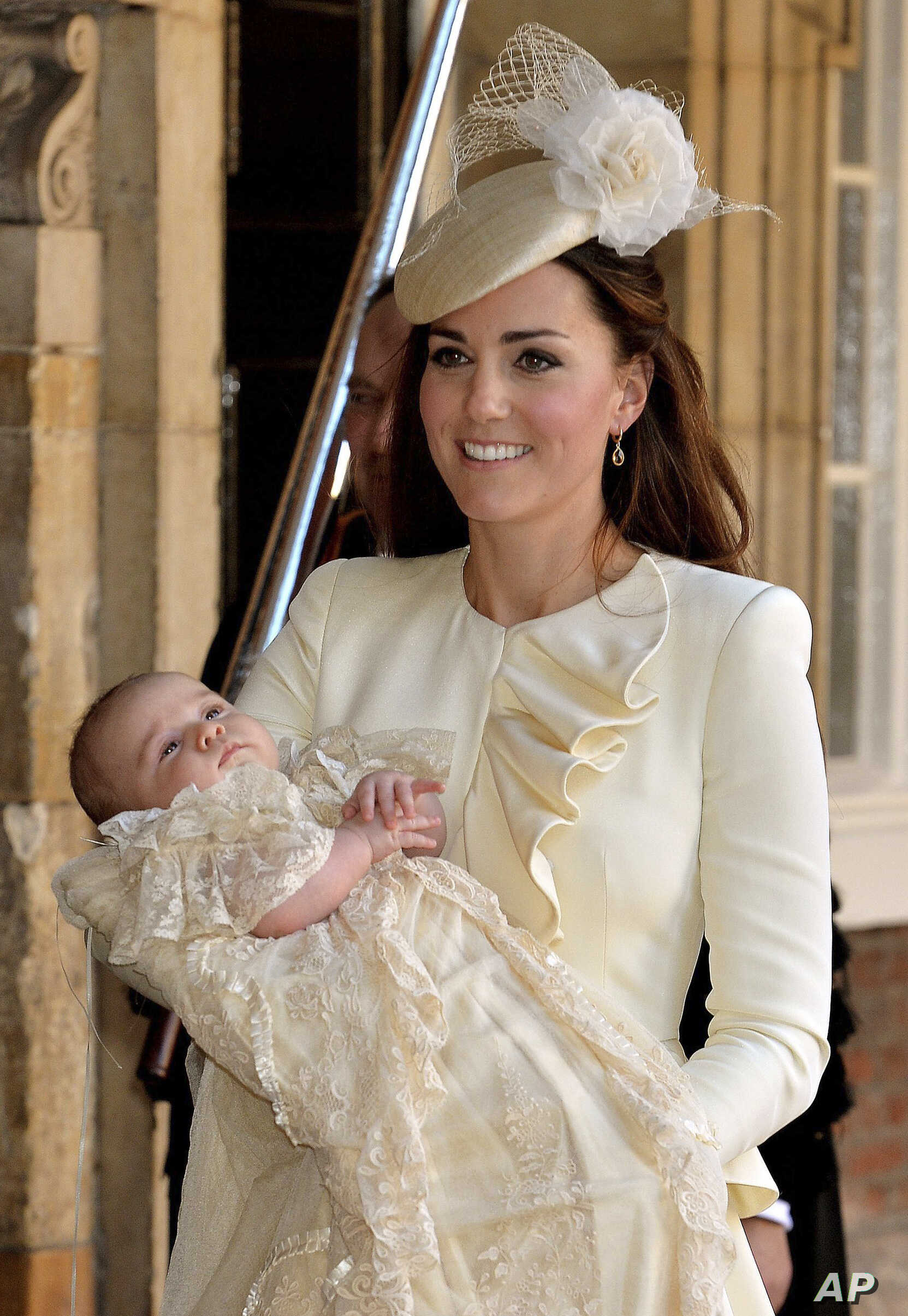 Kate, Duchess of Cambridge carries her son Prince George after his christening at the Chapel Royal in St. James's Palace in London, Oct. 23, 2013.