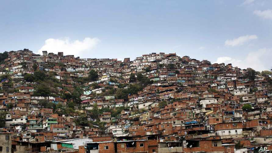 In this March 6, 2014 photo, a hill covered with low-income houses is seen in Petare district, Caracas, Venezuela.