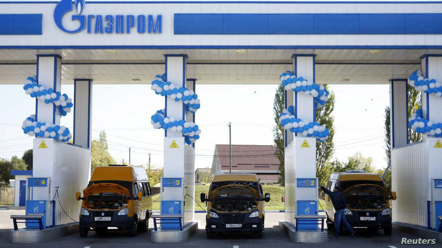 FILE - Vehicles are seen at a gas filling station, owned by Gazprom Transgaz Stavropol, with the company logo of Russian natural gas producer Gazprom seen on the station, in Stavropol in southern Russia.