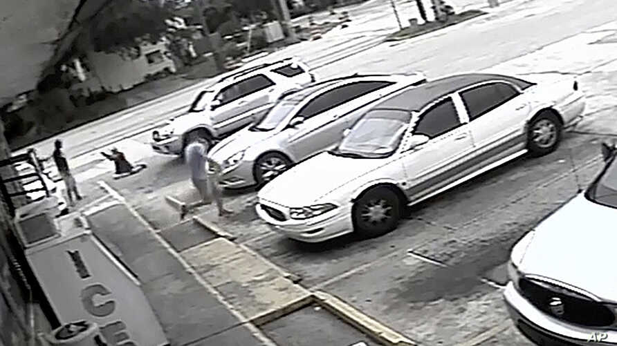 FILE - In this image taken from surveillance video released by the Pinellas County Sheriff's Office, Markeis McGlockton, far left, is shot by Michael Drejka during an altercation in the parking lot of a convenience store in Clearwater, Florida, July