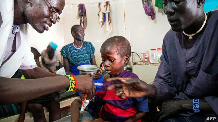 A medical officer from Doctors Without Borders (MSF) attends to a child with malnutrition in a clinic in Old Fangak, Jonglei state, on Aug. 18, 2017.