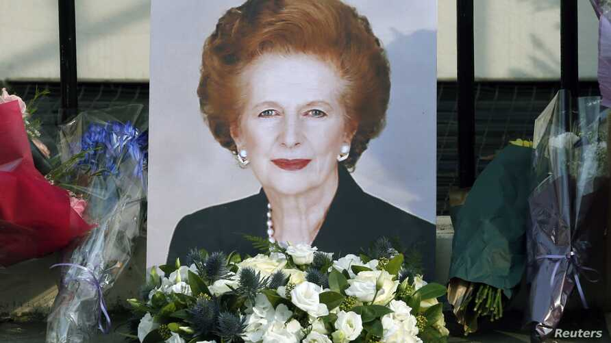 A portrait left by mourners is seen outside the home of former British Prime Minister Margaret Thatcher after her death was announced in London, April 8, 2013.
