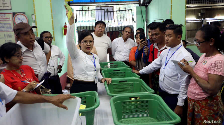 An Union Election Commission staff counts votes at a polling station during for the by-election in Yangon, Myanmar, Nov. 3, 2018.