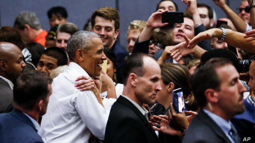 Former President Barack Obama greets supporters as he campaigns in support of California congressional candidates, Sept. 8, 2018, in Anaheim, Calif.