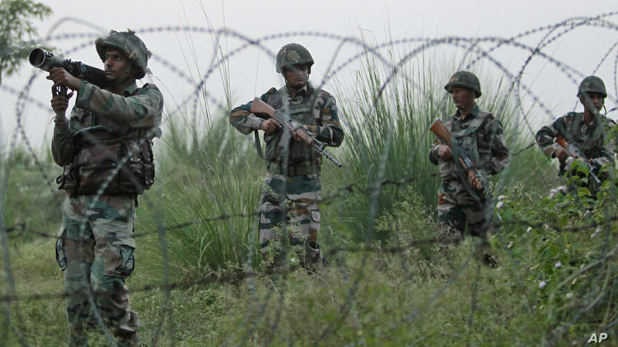Indian army soldiers patrol near the highly militarized Line of Control dividing Kashmir between India and Pakistan, in Pallanwal sector, about 75 kilometers from Jammu, India, Tuesday, Oct. 4, 2016. Pakistan and India traded fresh accusations of cro