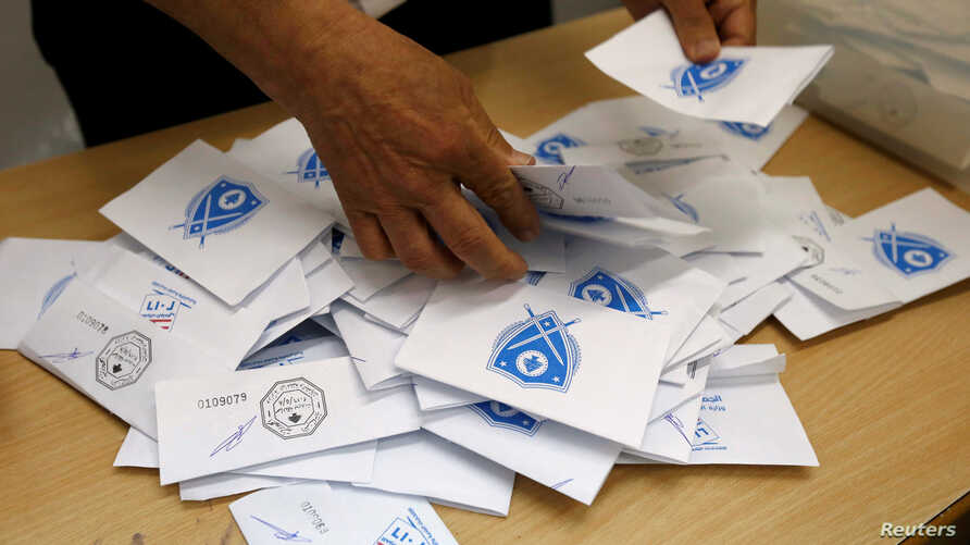 A Lebanese election official counts ballots after the polling station closed during Beirut's municipal elections in Lebanon, May 8, 2016.