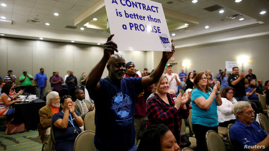 Leonard Smalls of the International Longshoremen's Association, shows his support during a rally held by the International Association of Machinists and Aerospace Workers for Boeing South Carolina workers before Wednesday's vote to organize, in North