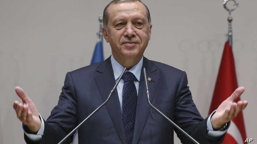 Turkey's President Recep Tayyip Erdogan, gestures as he delivers a speech during a ceremony to rejoin the ruling Justice and Development Party, or AKP, in Ankara, Turkey, May 2, 2017.