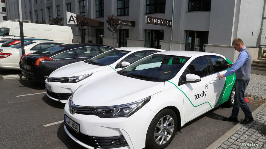 A Taxify driver enters his car in Tallinn, Estonia, June 13, 2017. The Estonia upstart is hoping to win over drivers and take on Uber.
