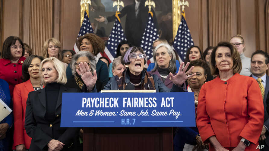 Rep. Rosa DeLauro, D-Conn., sponsor of the Paycheck Fairness Act, center, flanked by Lilly Ledbetter, left, an activist for workplace equality, and Speaker of the House Nancy Pelosi, D-Calif., speaks at an event to advocate for the Paycheck Fairness