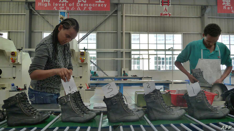 People work on the assembly line at a shoe factory in Dukem, Ethiopia, April 19, 2012.