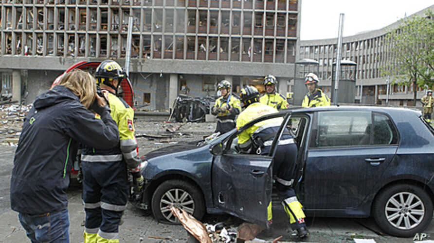 Rescue workers work at the scene of a powerful explosion that rocked central Oslo July 22, 2011