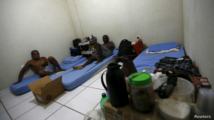 Laid-off workers of Comperj are pictured at a room of the Pousada do Trabalhador (Workers Inn), which closed down after the scandal involving Petrobras, on its last day of operations, in Itaborai March 31, 2015.