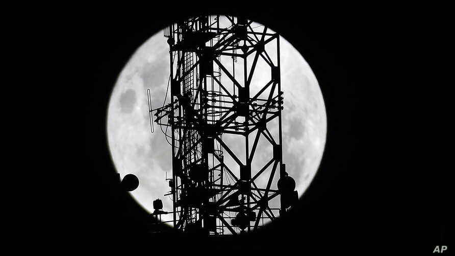 The telecommunications tower' is pictured as the moon passes into the earth's shadow during a lunar eclipse as seen in in Johannesburg, South Africa, Jan. 31, 2018.