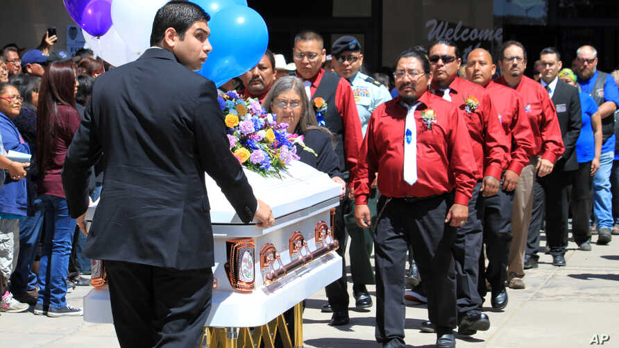 Pallbearers escort the casket of 11-year-old Ashlynne Mike out of the Civic Center following a memorial service, in Farmington, N.M.,May 6, 2016. Thousands of people from surrounding communities gathered at the center and along the procession route i